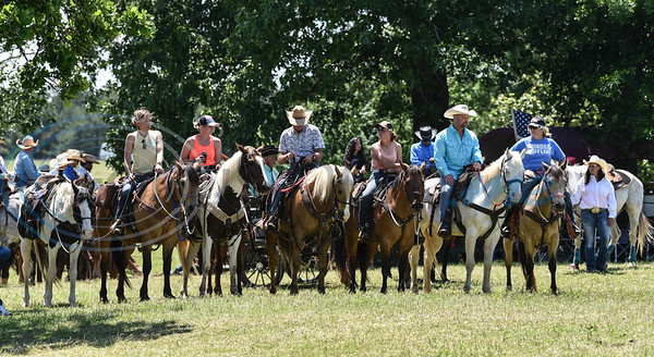Riders watch races from horseback during the 1836 Chuckwagon Races on Saturday, April 27. The annual event, in it's 7th year, takes place at the Diamond B Ranch in Neches. (Jessica T. Payne/Tyler Morning Telegraph)