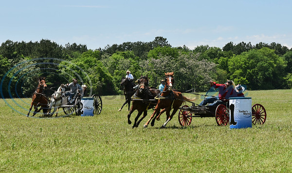 Teams round a barrel the Buckboard Wagons portion of the 1836 Chuckwagon Races on Saturday, April 27. The weeklong event took place at the Diamond B Ranch in Neches with winning teams competing in the finals on Sunday. (Jessica T. Payne/Tyler Morning Telegraph)
