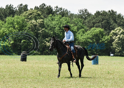 Diamond B Ranch owner and 1836 Chuckwagon Races organizer Moon Swanson looks on during a race on Saturday, April 27. The event took place at the ranch in Neches and celebrates the independence of Texas from Mexico. (Jessica T. Payne/Tyler Morning Telegraph)