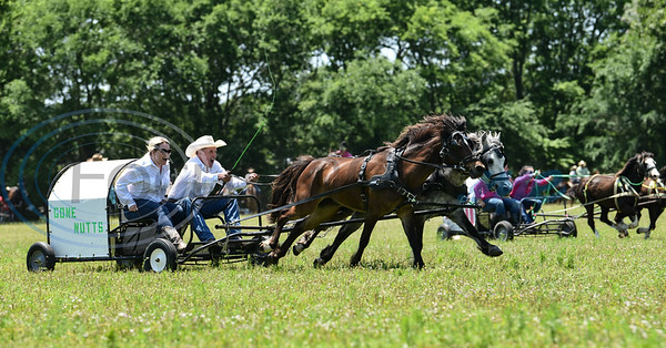 Wagons take off for the first race at the 1836 Chuckwagon Races in Neches. The event was held at Diamond B Ranch on Saturday, April 27 with winning teams competing in the finals on Sunday, April 28. (Jessica T. Payne/Tyler Morning Telegraph)