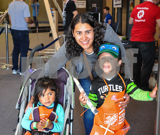 Arielle Varona, 2, (left), Damian Varona, 4, (right) and mother Aucencia Varona, 34, (middle) stop for a photo while enjoying the 6th Annual Tyler Maker Faire. The event took place at The Discovery Science Place on Saturday, April 28. (Jessica T. Payne/Tyler Paper)