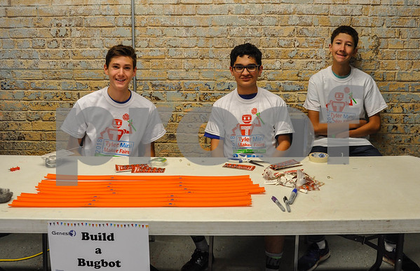 """(From left to right) Zane Harrison, 16, Dylan Mears, 15 and Christian Bain, 16, were all smiles while building bug bots at the 6th Annual Tyler Maker Faire held at The Discovery Science Place. The event, held on Saturday, April 28, featured more than 45 """"makers"""" and 5 food trucks for a day full of making, learning and hand-on fun for all ages. (Jessica T. Payne/Tyler Paper)"""