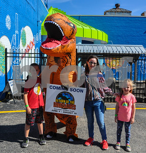 (From left to right) Joe Kirwin, 9, Lexie Fry, 13, and Abigail Robinson, 6, pose for a photo with the Discovery Science Place dinosaur at the 6th Annual Tyler Maker Faire. The event, held at The Discovery Science Place, took place on Saturday, April 28. (Jessica T. Payne/Tyler Paper)