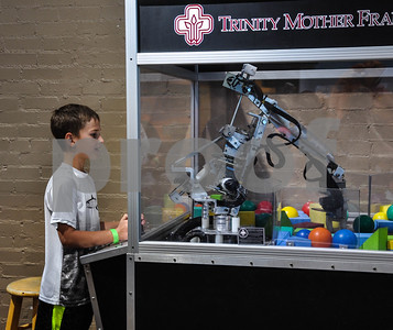 Brendon Dark, 9, works the Trinity Mother Frances robot-assisted surgery machine at the 6th Annual Tyler Maker Faire on Saturday, April 28. The event took place at The Discovery Science Place and offered hands-on fun for all ages. (Jessica T. Payne/Tyler Paper)