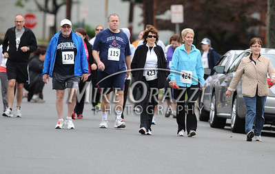 9/29/2012 Mike Orazzi | Staff The start of the 5K Run & Fitness Walk at the 43rd Mum-a-thon road race in downtown Bristol on Saturday morning.