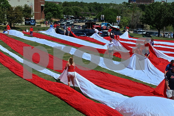 Assembling flag outside Globe Life Park by james bauer