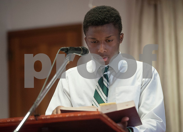 Rev. Emmanuel Milton-Tucson reads from the Bible during an event honoring the life and legacy of Dr. Martin Luther King, Jr. on Wednesday April 4, 2018 at Greater New Pleasant Hill Missionary Baptist Church in Tyler. King was assassinated April 4, 1968 at a hotel in Memphis, Tennessee.   (Sarah A. Miller/Tyler Morning Telegraph)