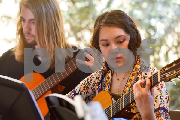 The Tyler Junior College Guitar Ensemble performs during Coffee House at the Tyler Museum of Art in Tyler, Texas, on Wednesday, April 4, 2018. The weekly Coffee House event, which features new musical groups each week for the month of April, is held in conjunction with TJC's fourth annual Arts Festival. (Chelsea Purgahn/Tyler Morning Telegraph)