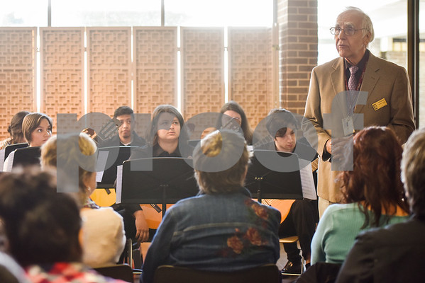 Frank Kimlicko, Professor of Music for Guitar, speaks before the Tyler Junior College Guitar Ensemble performs during Coffee House at the Tyler Museum of Art in Tyler, Texas, on Wednesday, April 4, 2018. The weekly Coffee House event, which features new musical groups each week for the month of April, is held in conjunction with TJC's fourth annual Arts Festival. (Chelsea Purgahn/Tyler Morning Telegraph)