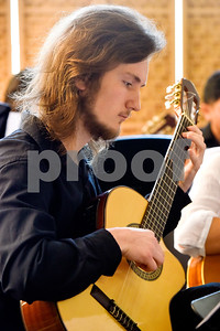 A member of the Tyler Junior College Guitar Ensemble performs during Coffee House at the Tyler Museum of Art in Tyler, Texas, on Wednesday, April 4, 2018. The weekly Coffee House event, which features new musical groups each week for the month of April, is held in conjunction with TJC's fourth annual Arts Festival. (Chelsea Purgahn/Tyler Morning Telegraph)