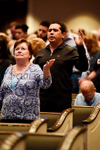 People pray during the re:new Gathering ahead of CityFest East Texas, which will be held in October, at Green Acres Baptist Church in Tyler, Texas, on Thursday, April 4, 2019. (Chelsea Purgahn/Tyler Morning Telegraph)