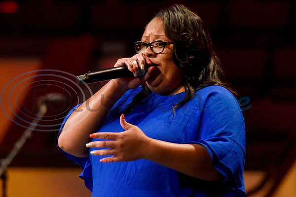 A woman sings during the re:new Gathering ahead of CityFest East Texas, which will be held in October, at Green Acres Baptist Church in Tyler, Texas, on Thursday, April 4, 2019. (Chelsea Purgahn/Tyler Morning Telegraph)