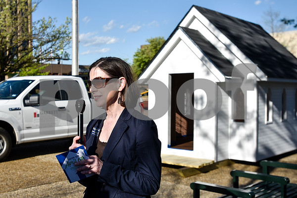 Deanna Harrison, Habitat for Humanity of Smith County director of development, speaks to the media after a church playhouse was moved to T.B. Butler Fountain Plaza in Tyler, Texas, on Thursday, March 30, 2017. Eight playhouses were built and donated for Playhouses on the Plaza, a live auction benefiting the Habitat for Humanity of Smith County. (Chelsea Purgahn/Tyler Morning Telegraph)