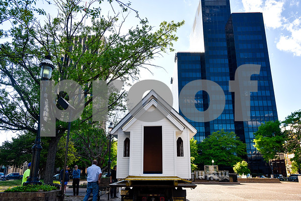 A church playhouse is moved to T.B. Butler Fountain Plaza in Tyler, Texas, on Thursday, March 30, 2017. Eight playhouses were built and donated for Playhouses on the Plaza, a live auction benefiting the Habitat for Humanity of Smith County. (Chelsea Purgahn/Tyler Morning Telegraph)