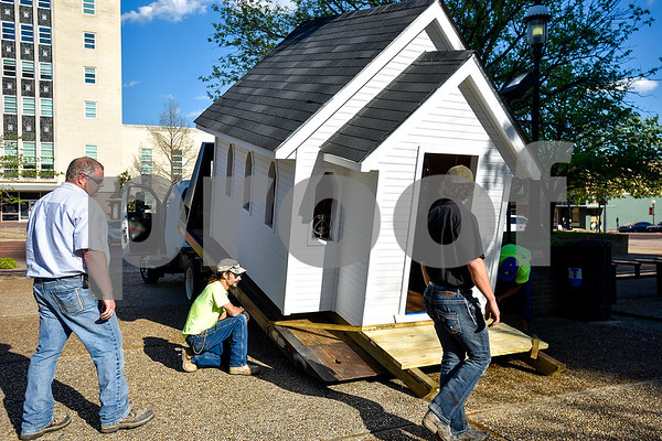 From left to right, Jeremy Palmer, Joshua Timms, Max Denkeler and Jorge Soto move a church playhouse to T.B. Butler Fountain Plaza in Tyler, Texas, on Thursday, March 30, 2017. Eight playhouses were built and donated for Playhouses on the Plaza, a live auction benefiting the Habitat for Humanity of Smith County. (Chelsea Purgahn/Tyler Morning Telegraph)