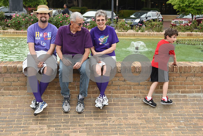 Cancer survivor Carl Lintner of Whitehouse, left, is pictured with his parents Gary and Patti Lintner and nephew Jude Lintner, 6, during Relay for Life of Smith County at the T.B. Butler Fountain Plaza Friday night April 8, 2016.  (Sarah A. Miller/Tyler Morning Telegraph)