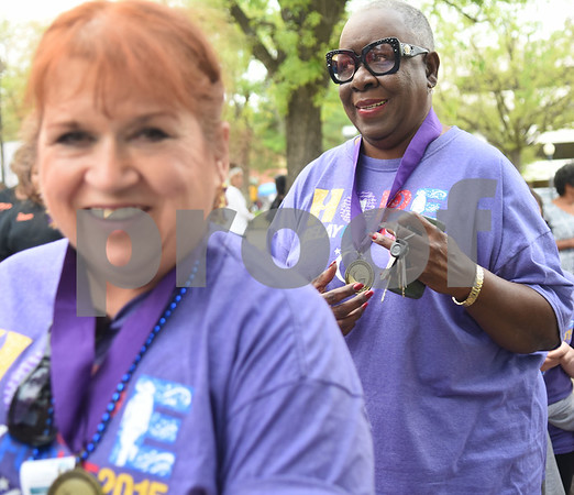 Cancer survivors Chris Smith and Devoria Ates are given medals during Relay for Life of Smith County at the T.B. Butler Fountain Plaza Friday night April 8, 2016.  (Sarah A. Miller/Tyler Morning Telegraph)