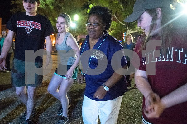 Cole Dickerson of Brownsboro, Chloe Bertrand of Brownsboro, Mimi Brooks of Tyler and Alissa Vandergriff of Brownsboro dance during Relay for Life of Smith County at the T.B. Butler Fountain Plaza Friday night April 8, 2016.  (Sarah A. Miller/Tyler Morning Telegraph)