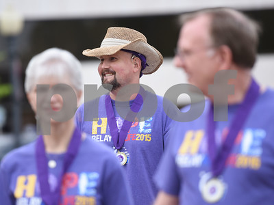 Cancer survivor Carl Lintner of Whitehouse, center, is pictured during Relay for Life of Smith County at the T.B. Butler Fountain Plaza Friday night April 8, 2016.  (Sarah A. Miller/Tyler Morning Telegraph)