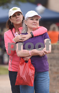 Kim DeMott of Tyler puts her arm around her sister-in-law Pat Neatherlin who is a cancer survivor during Relay for Life of Smith County at the T.B. Butler Fountain Plaza Friday night April 8, 2016.  (Sarah A. Miller/Tyler Morning Telegraph)