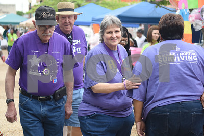 Cancer survivors Dennis Mayfield and Cathryn Cates walk around the T.B. Butler Fountain Plaza during Relay for Life of Smith County Friday night April 8, 2016.  (Sarah A. Miller/Tyler Morning Telegraph)
