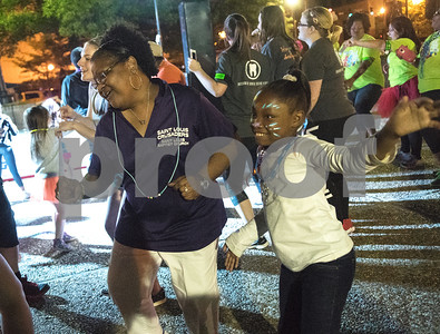 Mimi Brooks of Tyler dances with her granddaughter Cidora Moore, 8, during Relay for Life of Smith County at the T.B. Butler Fountain Plaza Friday night April 8, 2016.  (Sarah A. Miller/Tyler Morning Telegraph)