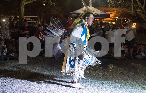 Joe Noah of Southern Dance Troupe performs a Native American dance during Relay for Life of Smith County at the T.B. Butler Fountain Plaza Friday night April 8, 2016.  (Sarah A. Miller/Tyler Morning Telegraph)