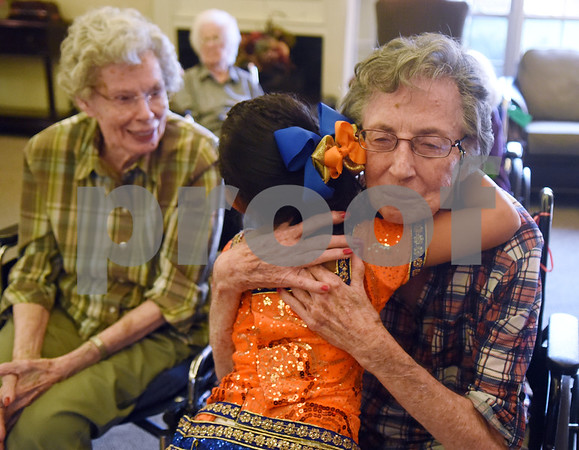 Jeeya Prasad, 6, hugs resident Jeanette Richey after performing a dance at The Heights of Tyler May 12, 2016. Several children involved in the Indian Association of East Texas performed for the senior citizens at The Heights.  (Sarah A. Miller/Tyler Morning Telegraph)
