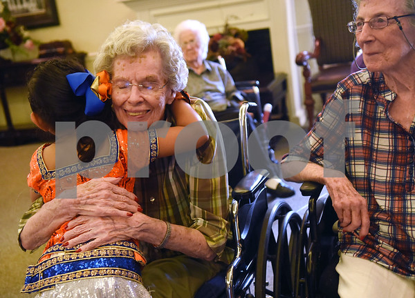 Jeeya Prasad, 6, hugs resident LaVelle Smith after performing a dance at The Heights of Tyler May 12, 2016. Several children involved in the Indian Association of East Texas performed for the senior citizens at The Heights.  (Sarah A. Miller/Tyler Morning Telegraph)