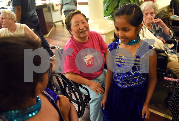 Resident Hwa Park is visited by dancers Diya Patel, 8, and  Anjali Patel, 7, after performing a dance May 12, 2016. Several children involved in the Indian Association of East Texas performed for the senior citizens at at The Heights of Tyler.  (Sarah A. Miller/Tyler Morning Telegraph)