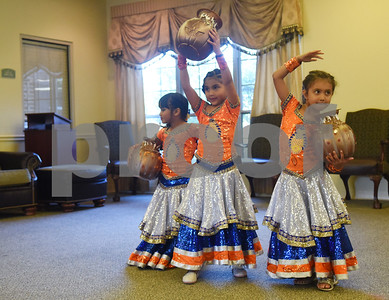 Freya Park, 5, Jeeya Prasad, 6, and Sonia Torres, 5, pose at the end of a dance at The Heights of Tyler May 12, 2016. Several children involved in the Indian Association of East Texas performed for the senior citizens at The Heights.  (Sarah A. Miller/Tyler Morning Telegraph)