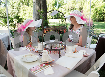 Victoria Brantley, 9, of Longview, wears matching hats with her mother Julie Brantley during the 7th Annual Mother's Day Tea at Walker Manor Bed & Breakfast in Gladewater Saturday May 13, 2017.  (Sarah A. Miller/Tyler Morning Telegraph)