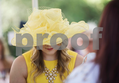 Samantha Shail of Gilmer wears a yellow hat during the 7th Annual Mother's Day Tea at Walker Manor Bed & Breakfast in Gladewater Saturday May 13, 2017.  (Sarah A. Miller/Tyler Morning Telegraph)