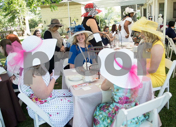 Julie Brantley of Longview and her daughter Victoria Brantley, 9, have tea with Lonna Shail and Samantha Shail of Gilmer during the 7th Annual Mother's Day Tea at Walker Manor Bed & Breakfast in Gladewater Saturday May 13, 2017.  (Sarah A. Miller/Tyler Morning Telegraph)