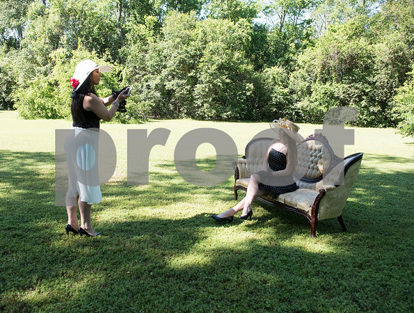 Kimberly Holiday of Longview takes a photo of her daughter Bentley Holiday during the 7th Annual Mother's Day Tea at Walker Manor Bed & Breakfast in Gladewater Saturday May 13, 2017.  (Sarah A. Miller/Tyler Morning Telegraph)