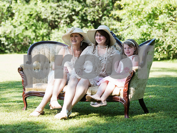Lori Sizemore of White Oak, center, has her photo taken on a vintage couch with her mother Tercia Collier, left, and daughter Novah Sizemore, 6, at right, during the 7th Annual Mother's Day Tea at Walker Manor Bed & Breakfast in Gladewater Saturday May 13, 2017.  (Sarah A. Miller/Tyler Morning Telegraph)