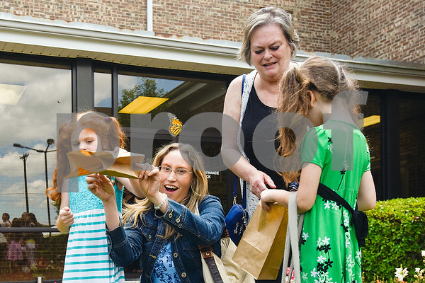 People release monarch butterflies during a butterfly release at Colonial Hills Baptist Church in Tyler, Texas, on Sunday, May 14, 2017. Joel Enge has been raising butterflies as a hobby for 16 years and typically does a butterfly release each year with either his students or his church. (Chelsea Purgahn/Tyler Morning Telegraph)