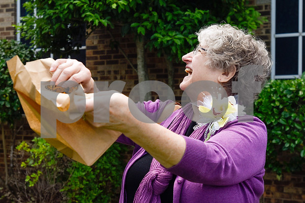 Elizabeth White smiles as she looks at monarch butterflies flying and she releases one of her own during a butterfly release at Colonial Hills Baptist Church in Tyler, Texas, on Sunday, May 14, 2017. Joel Enge has been raising butterflies as a hobby for 16 years and typically does a butterfly release each year with either his students or his church. (Chelsea Purgahn/Tyler Morning Telegraph)