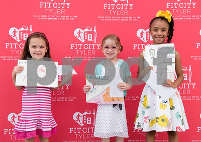 Clarkson Elementary third grader Anna Ledyard won third place, Clarkson Elementary second grader Maryanna Bennett won second place and Clarkson Elementary first grader Kayden Barrett won first place in the K-2nd grade division of the Fit For Life Youth Art Contest, part of the Lighten Up East Texas regional weight loss challenge.  (Sarah A. Miller/Tyler Morning Telegraph)