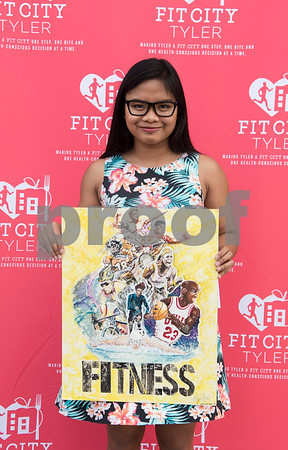 Robert E. Lee sophomore Aveanne Tugano won first place in the 9th-12th grade division of the Fit For Life Youth Art Contest, part of the Lighten Up East Texas regional weight loss challenge.  (Sarah A. Miller/Tyler Morning Telegraph)