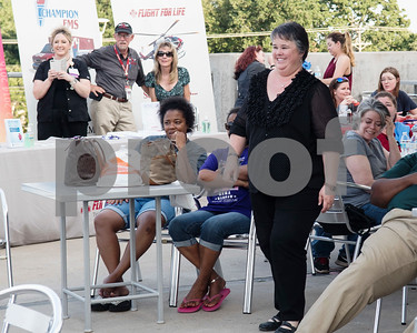 Cynthia Roegner of Athens smiles after winning a $1000 Brookshires gift card from the Lighten Up East Texas regional weight loss challenge during the Fit City Tyler Celebration Event held at Fresh Tuesday May 16, 2017.  (Sarah A. Miller/Tyler Morning Telegraph)