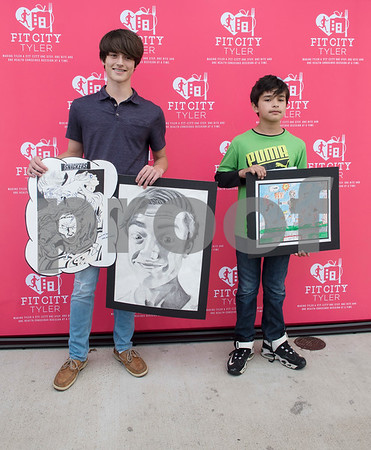 East Texas Christian Academy eight grader William Hayes won second place and Boulter Middle School seventh grader Antonio Moore won first place in the 6th-8th grade division of the Fit For Life Youth Art Contest, part of the Lighten Up East Texas regional weight loss challenge.  (Sarah A. Miller/Tyler Morning Telegraph)