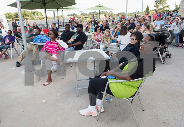 People wait on the patio at Fresh during the Fit City Tyler Celebration Event for the announcement of door prize winners and grand prize winners of the Lighten Up East Texas regional weight loss challenge.  (Sarah A. Miller/Tyler Morning Telegraph)