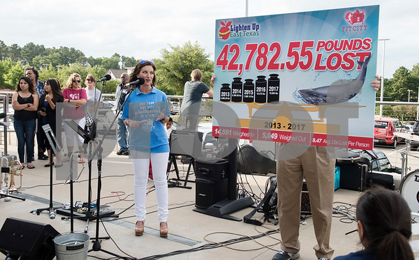 Dana Hughey of television station CBS 19 announces the total weight loss from competitors in the Lighten Up East Texas regional weight loss challenge over the past five years during the Fit City Tyler Celebration Event held at Fresh Tuesday May 16, 2017.  (Sarah A. Miller/Tyler Morning Telegraph)