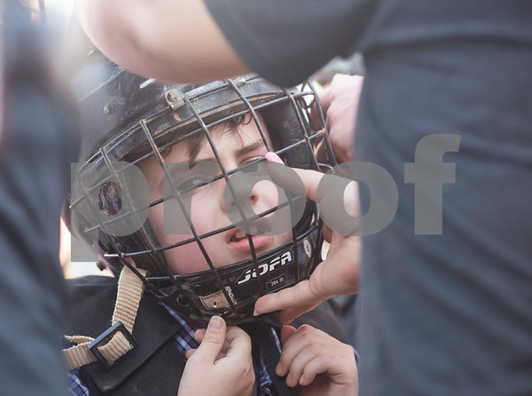 Levi Whitley, 6, of Hideaway has help putting on his helmet before competing in the mutton bustin' event at the Lindale Championship Rodeo on Thursday May 17, 2018 in Lindale. The rodeo continues on Saturday at 7:30 p.m.  (Sarah A. Miller/Tyler Morning Telegraph)