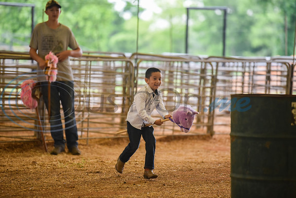Lorenzo Marquez, 4, rides a stick horse at the Special Needs Junior Rodeo in Jacksonville on Saturday, May 18. The event is part of the annual TOPS in Texas Rodeo. (Jessica T. Payne/Tyler Morning Telegraph)