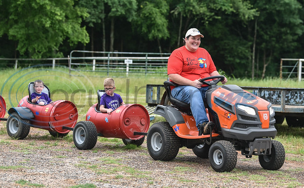 Young kids catch a ride at the Special Needs Junior Rodeo in Jacksonville on Saturday, May 18. The event is part of the annual TOPS in Texas Rodeo. (Jessica T. Payne/Tyler Morning Telegraph)