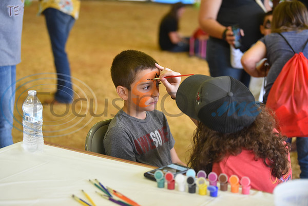 Eleazar Marquez, 6, gets his face painted at the Special Needs Junior Rodeo put on by the TOPS in Texas Rodeo. The event took place in Jacksonville on Saturday, May 18. (Jessica T. Payne/Tyler Morning Telegraph)