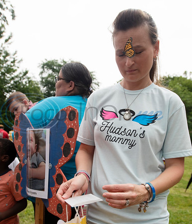 Tiffany Ayers of Rusk releases a butterfly for her son Hudson Ayers at the Tyler Compassionate Friends butterfly release at The Children's Park in Tyler on Saturday May 18, 2019. The event recognizes children who have died and is attended by parents, siblings and other family members.  (Sarah A. Miller/Tyler Morning Telegraph)