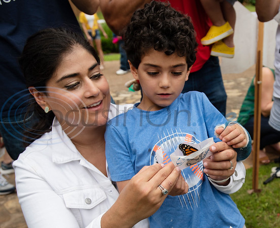 Monica Khirallah of Dallas and her son David, 6, release a butterfly in honor of her son Daniel Khirallah who was stillborn. The Tyler Compassionate Friends host a butterfly release each year for parents and siblings who have lost a child.  (Sarah A. Miller/Tyler Morning Telegraph)